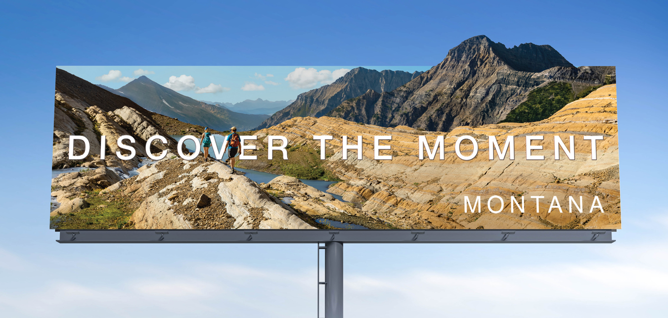 """Montana Tourism billboard ad that says """"Discover the Moment"""""""