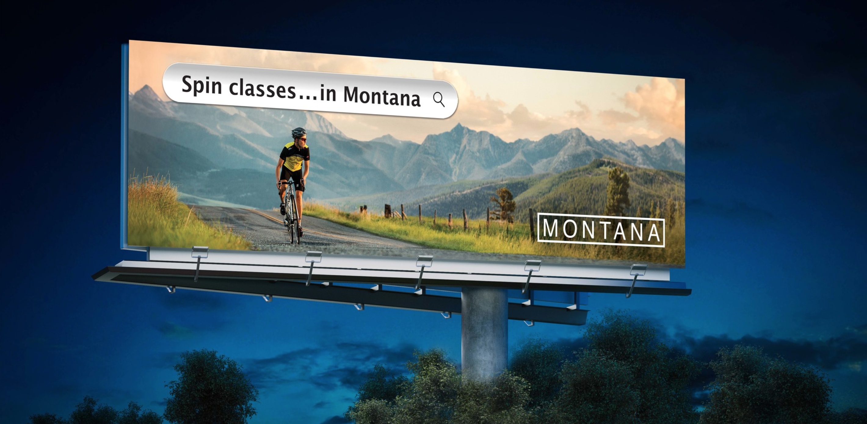 "A billboard featuring a man riding a bike and a search bar above his head that reads: ""Spin classes...in Montana"""