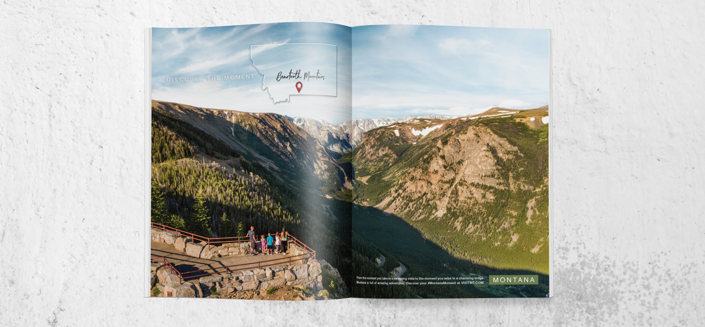 Montana Tourism full magazine spread featuring a family overlooking the Beartooth Mountains.