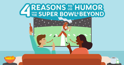 Couple at home laughing at humorous Super Bowl commercials during the big game
