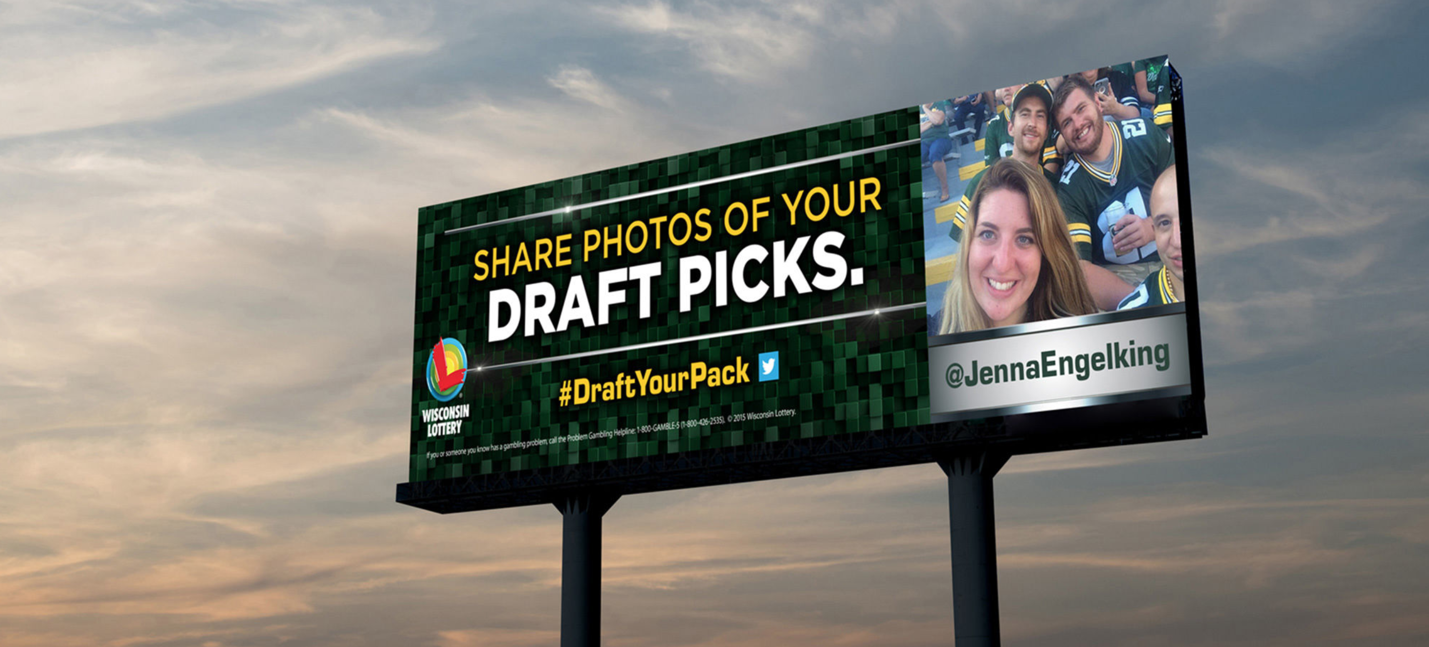 "A billboard featuring a group of friends at a Green Bay Packer's game and text that says ""Share photos of your draft picks"""